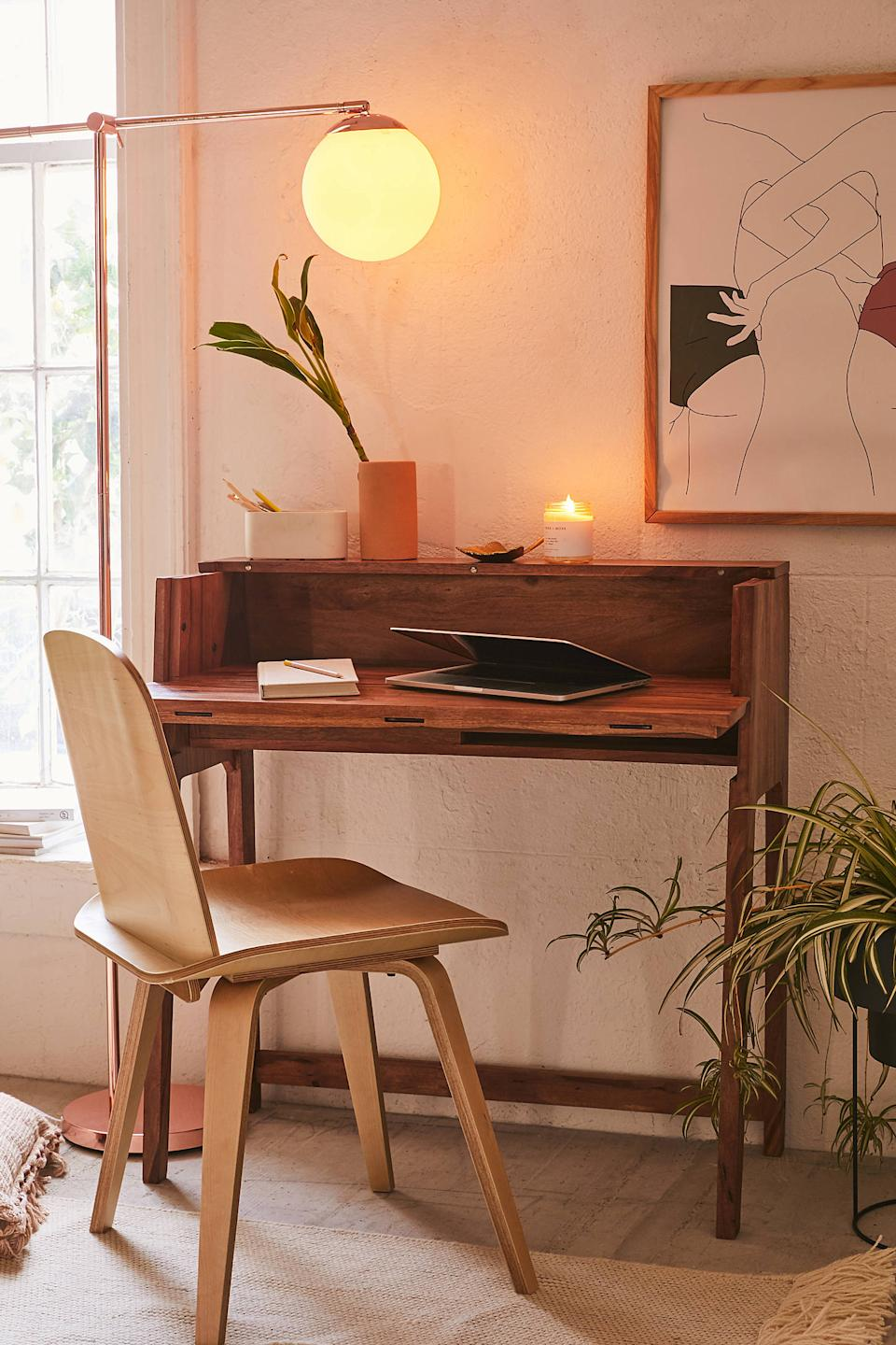 """<h3>Urban Outfitters Mid-Century Fold Out Desk<br></h3> <br>Don't sacrifice style for space by investing in a desk with a solid, durable design that's built to fold up out of the way when not in use.<br><br><strong>Urban Outfitters</strong> Mid-Century Fold Out Desk, $, available at <a href=""""https://go.skimresources.com/?id=30283X879131&url=https%3A%2F%2Fwww.urbanoutfitters.com%2Fshop%2Fmid-century-fold-out-desk"""" rel=""""nofollow noopener"""" target=""""_blank"""" data-ylk=""""slk:Urban Outfitters"""" class=""""link rapid-noclick-resp"""">Urban Outfitters</a>"""