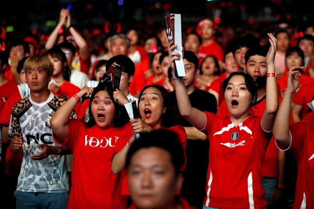 South Korean fans react as they watch the broadcast of the World Cup Group F soccer match between Sweden and South Korea, in central Seoul, South Korea, June 18, 2018. REUTERS/Kim Hong-Ji