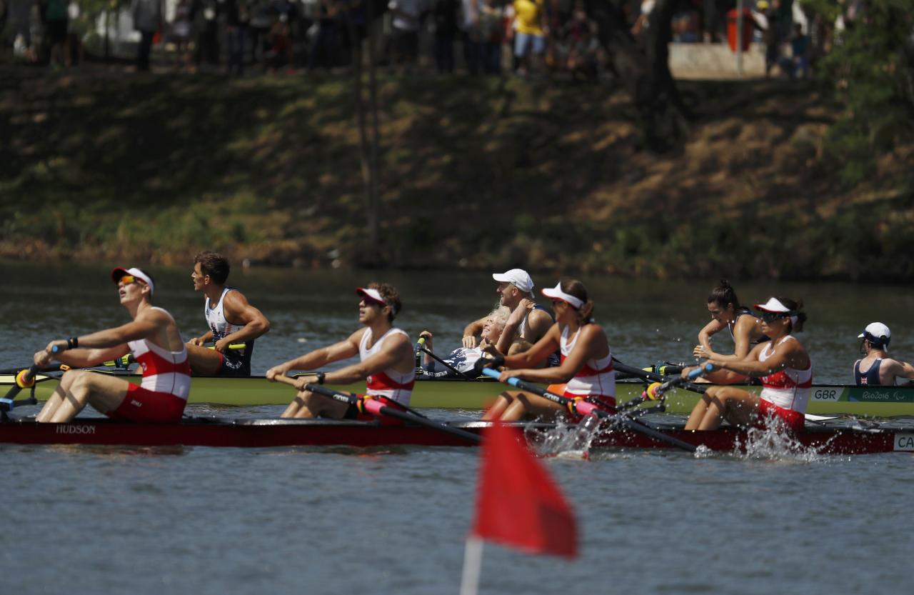 2016 Rio Paralympics - Rowing- Final - LTA Mixed Coxed Four LTAMIX4+ Final - Lagoa Stadium - Rio de Janeiro, Brazil - 11/09/2016. Bronze medalists (front) Victoria Nolan, Meghan Montgomery, Andrew Todd, Curtis Halladay and Kristen Kit of Canada and gold medalists Grace Clough, Daniel Brown, Pamela Relph, James Fox and Oliver James of Britain react after the finish. REUTERS/Ricardo Moraes   FOR EDITORIAL USE ONLY. NOT FOR SALE FOR MARKETING OR ADVERTISING CAMPAIGNS.