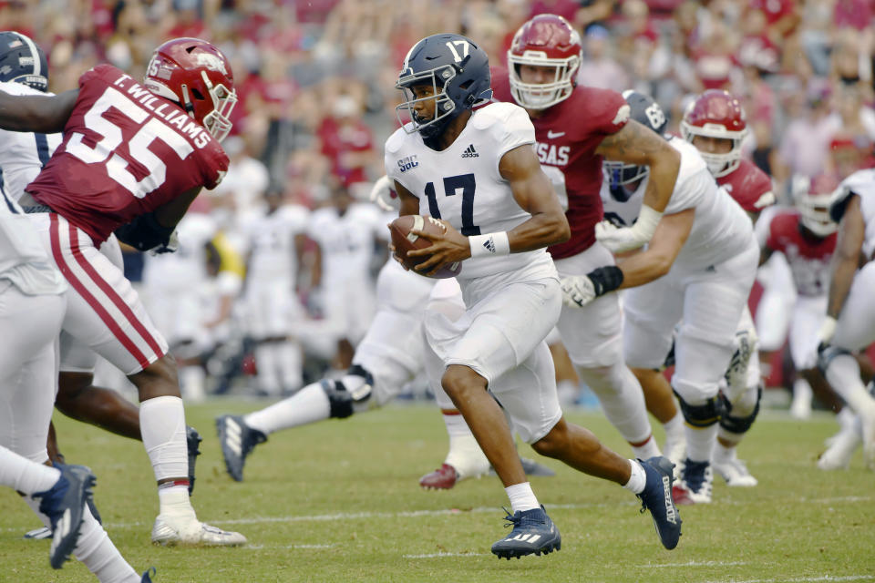 Georgia Southern quarterback Justin Tomlin (17) runs the ball against Arkansas during the first half of an NCAA college football game Saturday, Sept. 18, 2021, in Fayetteville, Ark. (AP Photo/Michael Woods)