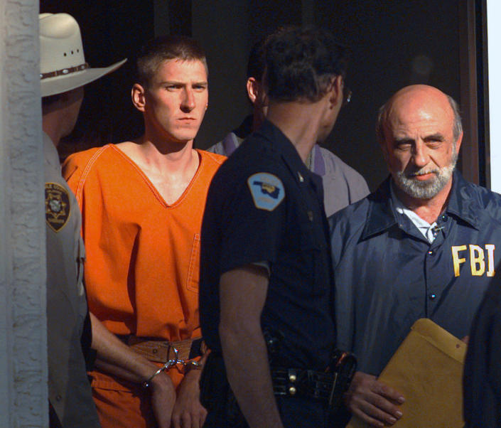 Timothy McVeigh is led out of the Noble County Courthouse in Perry, Okla., on April 21, 1995. (John Gaps III/AP File)
