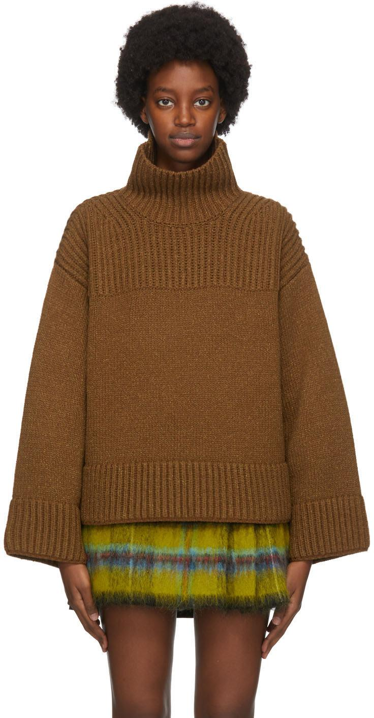 Acne Studios Brown Wool & Silk Rib Knit Turtleneck. Image via SSENSE.