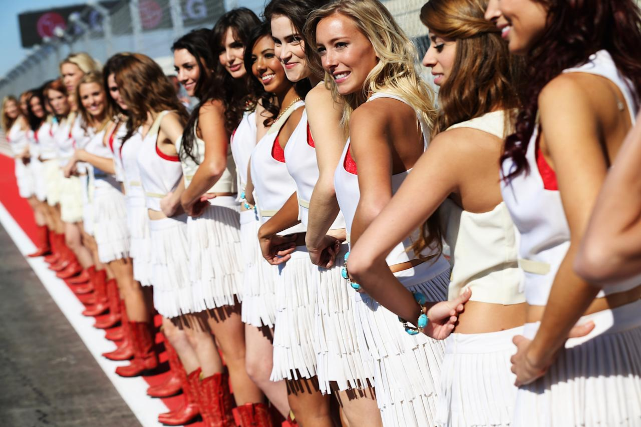 AUSTIN, TX - NOVEMBER 18:  Grid girls line up for the drivers parade before the United States Formula One Grand Prix at the Circuit of the Americas on November 18, 2012 in Austin, Texas.  (Photo by Mark Thompson/Getty Images)