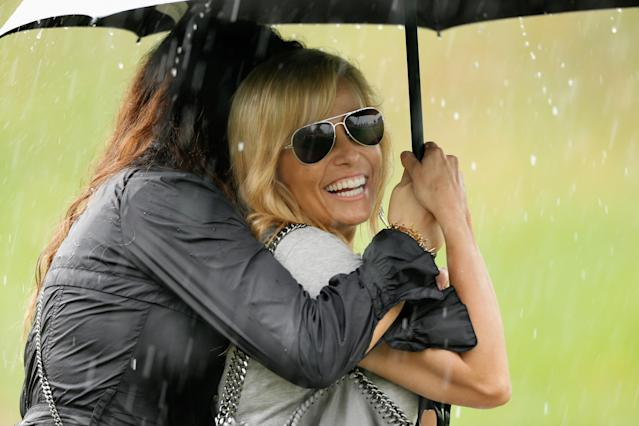 DUBLIN, OH - OCTOBER 05: Amy Mickelson waits under an umbrella during a weather-delay during the Day Three Four-ball Matches at the Muirfield Village Golf Club on October 5, 2013 in Dublin, Ohio. (Photo by Gregory Shamus/Getty Images)