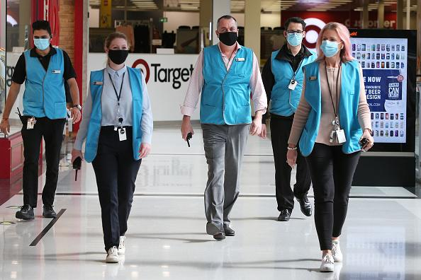 Members of the Broadway Shopping Centre team are seen wearing face masks in Sydney, Australia.