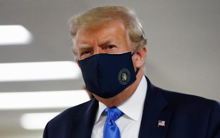 US President Donald Trump now chooses to occasionally wear a face mask - Patrick Semansky/AP