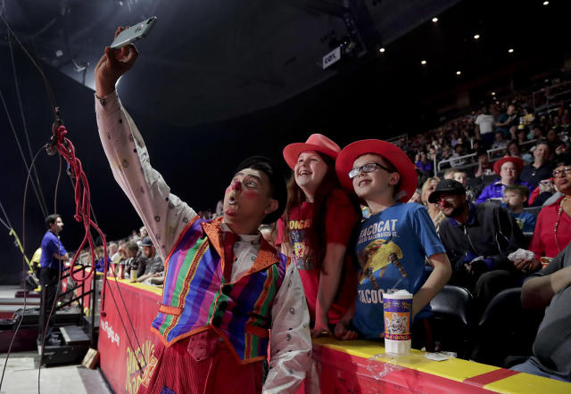 """<p>Ringling Bros. clown Ivan Skinfill poses for a selfie photo with children during the intermission of a show, Thursday, May 4, 2017, in Providence, R.I. """"The Greatest Show on Earth"""" is about to put on its last show on earth. For the performers who travel with the Ringling Bros. and Barnum & Bailey Circus, its demise means the end of a unique way of life for hundreds of performers and crew members. (Photo: Julie Jacobson/AP) </p>"""