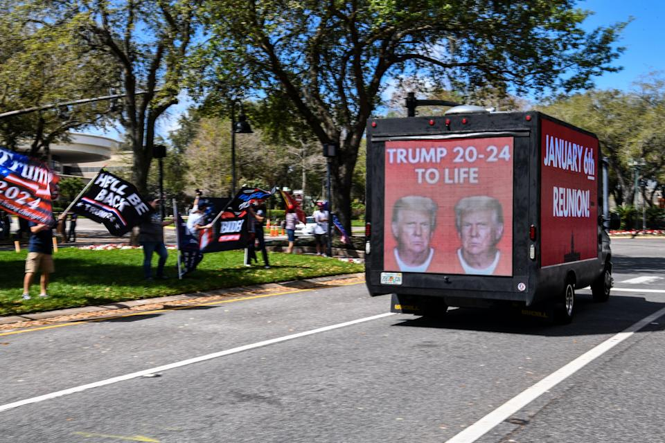 <p>Trucks outside CPAC with 'January 6th Reunion' on them ahead of Trump speech</p> (Photo by CHANDAN KHANNA/AFP via Getty Images)