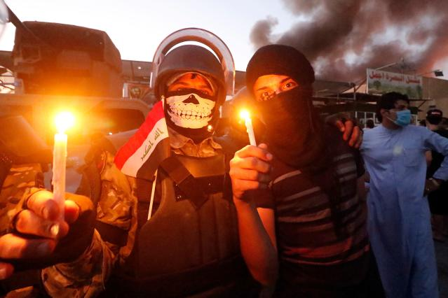 <p>Iraqi protesters light candles in front of official buildings as they demonstrate against the government and the lack of basic services in Basra on Sept. 6, 2018. (Photo: Haidar Mohammed Ali/AFP/Getty Images) </p>