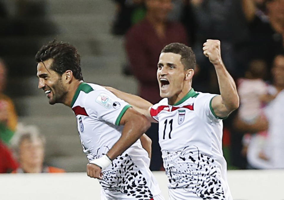 Iran's Masoud Shojaei (L) celebrates his goal against Bahrain with Vouria Ghafouri during their Asian Cup Group C soccer match at the Rectangular stadium in Melbourne January 11, 2015. REUTERS/Brandon Malone (AUSTRALIA - Tags: SOCCER SPORT)