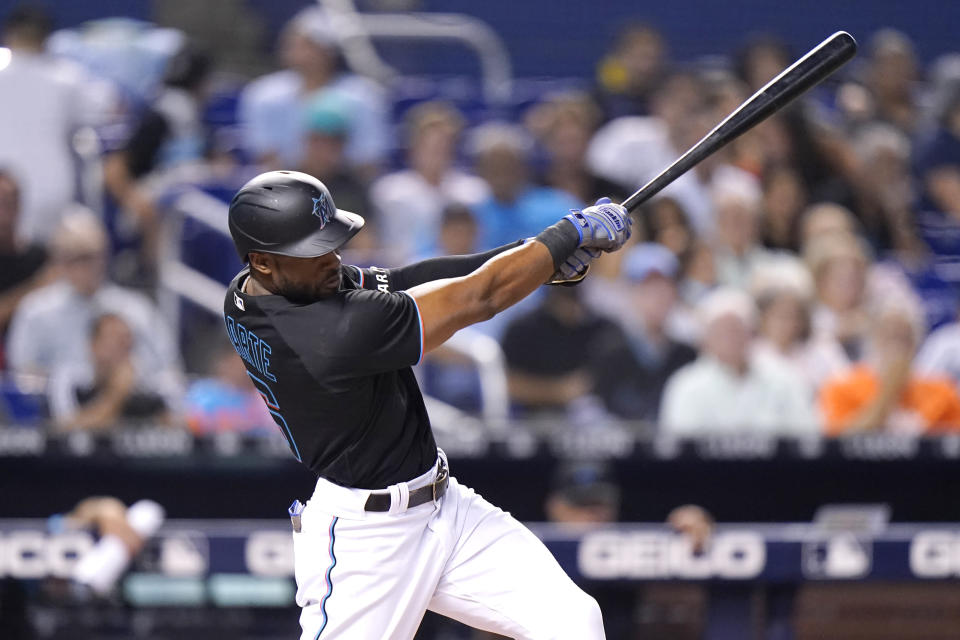 Miami Marlins' Starling Marte hits a single during the first inning of the team's baseball game against the San Diego Padres, Friday, July 23, 2021, in Miami. (AP Photo/Lynne Sladky)