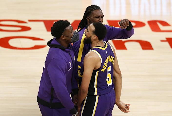 Lakers guard Talen Horton-Tucker, right, celebrates with teammates after a 101-99 victory over the New York Knicks.