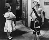 <p>A still shot from the movie <em>Wee Willie Winkie </em>with Temple sharing the screen with Douglas Scott. </p>