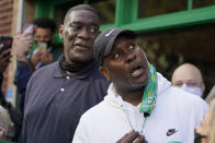 Shawn Kemp, left, a former NBA basketball player for the Seattle SuperSonics and several other teams, is joined by his former teammate and basketball Hall-of-Famer Gary Payton, right, Friday, Oct. 30, 2020, at the ribbon-cutting ceremony for the grand opening of Shawn Kemp's Cannabis, the marijuana dispensary he owns with several business partners in downtown Seattle. (AP Photo/Ted S. Warren)