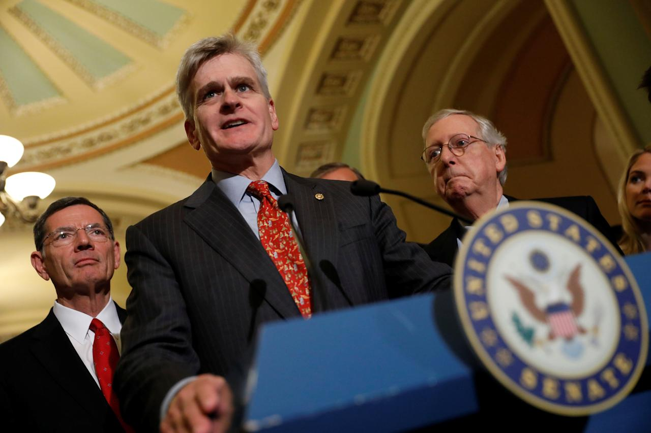 Sen. Bill Cassidy (R-LA), accompanied by Sen. John Barrasso (R-WY) and Senate Majority Leader Mitch McConnell, speaks with reporters about the Cassidy/Graham healthcare bill following the party luncheons on Capitol Hill in Washington, U.S., September 19, 2017. REUTERS/Aaron P. Bernstein