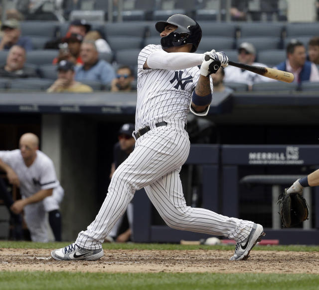 New York Yankees' Gleyber Torres watches his grand slam during the seventh inning of a baseball game against the Tampa Bay Rays at Yankee Stadium, Wednesday, June 19, 2019, in New York. (AP Photo/Seth Wenig)