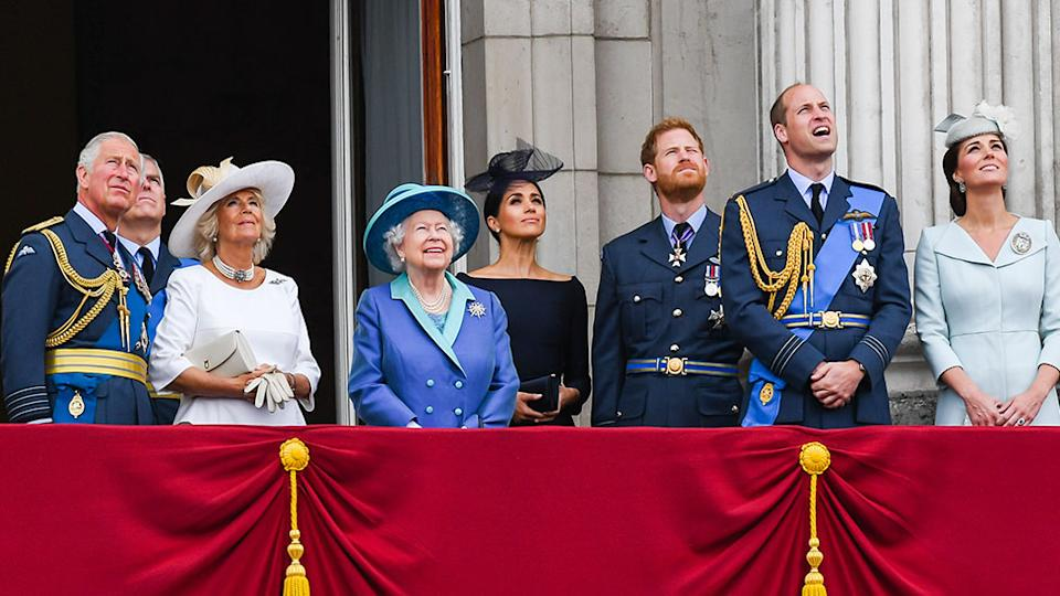 The Royal Family stand on a balcony