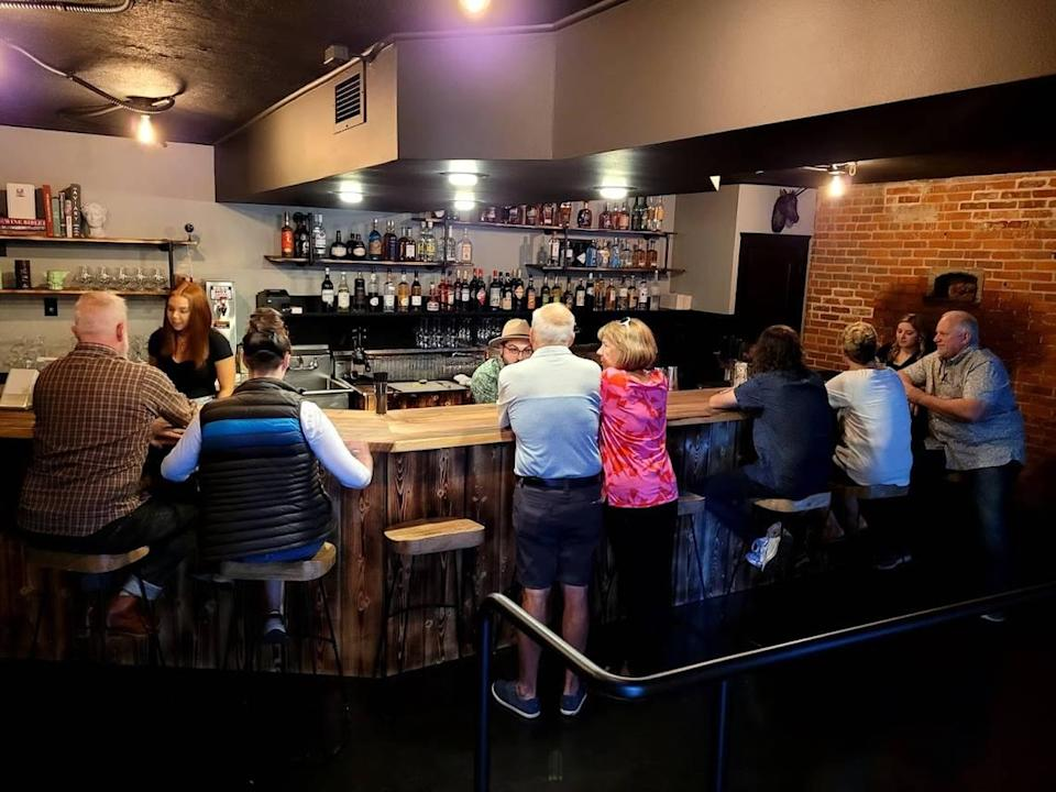 Guests enjoy drinks during a soft opening of downtown Boise's newest bar.