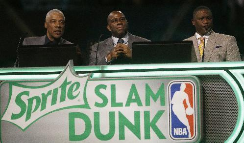 "Former NBA players' Julius Erving, Earvin ""Magic"" Johnson, Jr. and Dominique Wilkins judge the slam dunk contest during the skills competition at the NBA All Star basketball game, Saturday, Feb. 15, 2014, in New Orleans. (AP Photo/Gerald Herbert)"