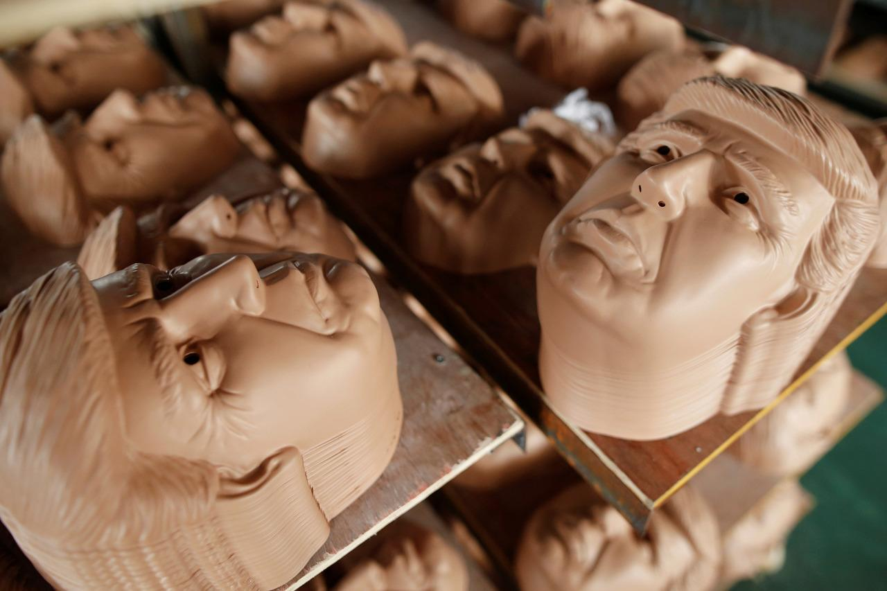 <p>Masks of presumtive Republican presidential nominee Donald Trump are seen drying on shelves at Jinhua Partytime Latex Art and Crafts Factory in Jinhua, China, on May 25, 2016.(Photo: Aly Song/Reuters) </p>
