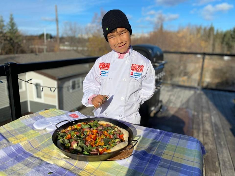 Drew Sinclair, 10, was one of 26 winners of the Kid Food Nation recipe contest, by creating a recipe for smoked meat bannock pizza. (Chantal Dubuc/CBC - image credit)