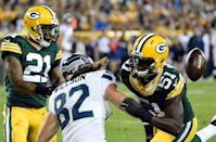 Green Bay Packers linebacker Nate Palmer (51) and safety Ha Ha Clinton-Dix (21) breaks up a pass intended for Seattle Seahawks tight end Luke Willson (82) in the fourth quarter at Lambeau Field. Sep 20, 2015; Green Bay, WI, USA. Benny Sieu-USA TODAY Sports