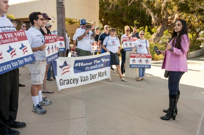"""<div class=""""inline-image__caption""""><p>""""Gracey Van Der Mark, right, speaks to supporters prior to a special meeting of the Huntington Beach City Council in Huntington Beach on Monday, July 19, 2021 to choose a replacement for Tito Ortiz's seat out of more than 100 applicants.""""</p></div> <div class=""""inline-image__credit"""">MediaNews Group/Orange County Register via Getty</div>"""