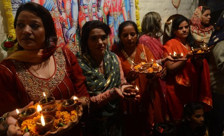 Pakistani Hindus carry oil lamps on the occasion of Diwali in Lahore on November 13, 2012. Diwali, the festival of lights, is celebrated with jubilation and enhusiasm as one of the biggest Hindu festivals. People decorate their homes with flowers and Diyas (earthen lamps) to celebrate the homecoming of the God Ram after vanquishing the demon king Ravana and honour the Hindu goddess of wealth, Lakshmi. AFP PHOTO/Arif ALI