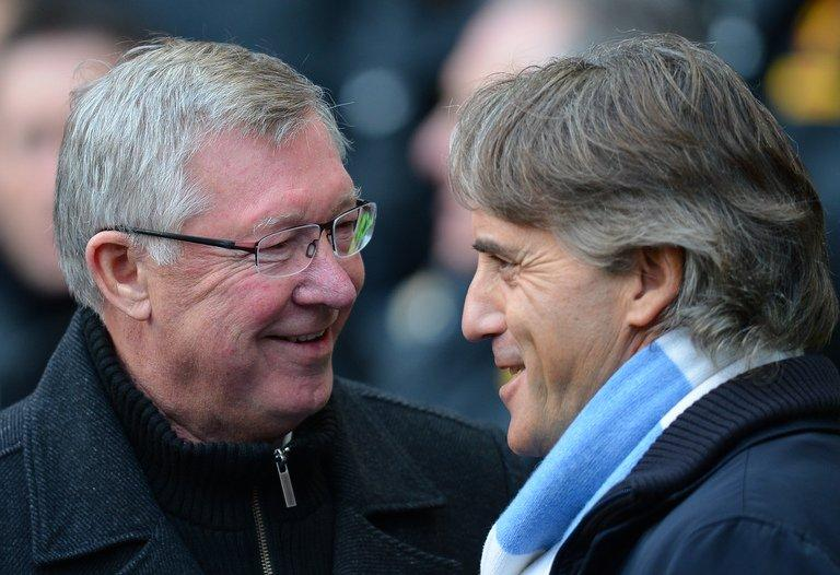United manager Alex Ferguson (L) talks to City manager Roberto Mancini (R) at The Etihad stadium on December 9, 2012
