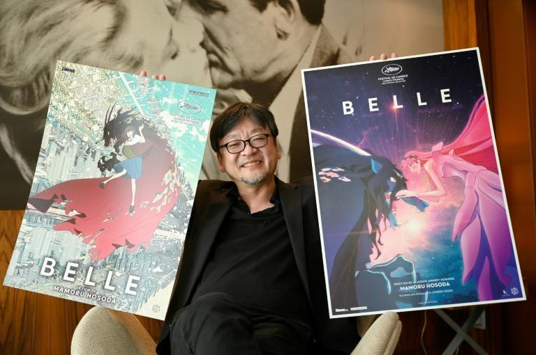 Belle and the Beast: Japanese animation director Hosoda with posters of his new film, 'Belle'