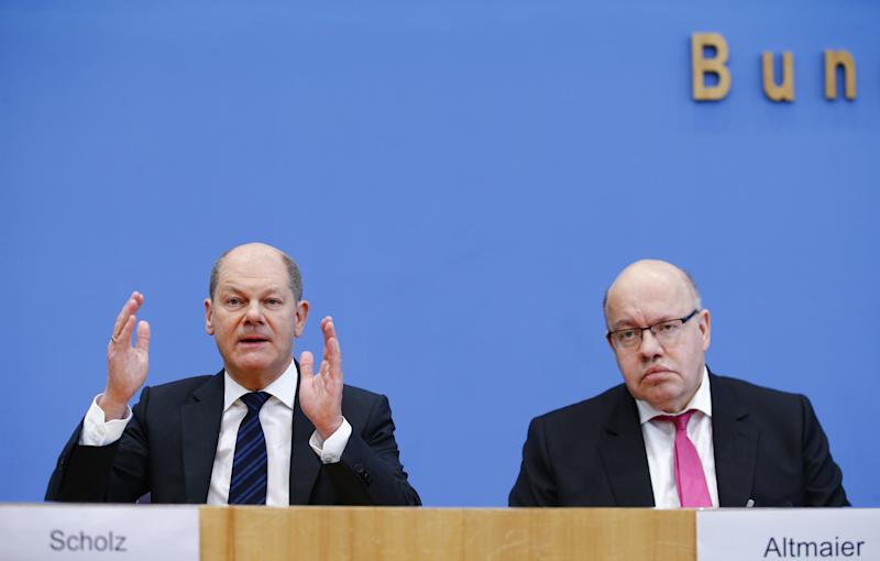 BERLIN, GERMANY - MARCH 13: German Minister of Finance Olaf Scholz (L) and Minister of Economics and Energy Peter Altmaier (R) hold a press conference on coronavirus (Covid-19) outbreak and economic impact in Berlin, Germany on March 13, 2020. (Photo by Abdulhamid Hosbas/Anadolu Agency via Getty Images)