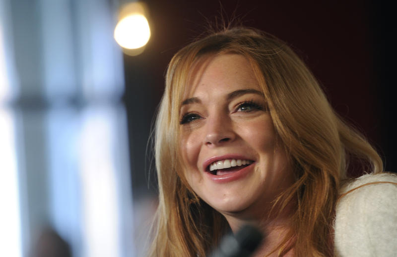 "Actress Lindsay Lohan addresses reporters during a news conference at the 2014 Sundance Film Festival, Monday, Jan. 20, 2014, in Park City, Utah. Producer Randall Emmett and Lohan announced the forthcoming production of a new film, ""Inconceivable,"" in which Lohan will star and co-produce. (Photo by Chris Pizzello/Invision/AP)"