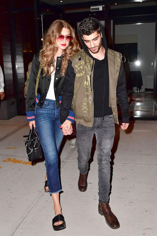 """<p>In a black bomber jacket, white tee, <a href=""""http://www.7forallmankind.com/highwaist-ankle-straight-with-raw-hem-in-acroplis-deep-sky/d/12533C19485?CategoryId=3042"""" target=""""_blank"""">7 for All Mankind</a> high-waisted raw hem cropped jeans, black slides and tinted aviator sunglasses.</p>"""