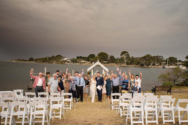 The couple and their guests can be seen waving at the camera in celebration. Source: Rebecca Farley Photography