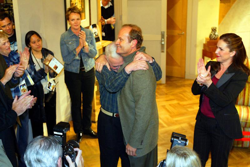 "Grammer and Mahoney hug during the final taping of ""Frasier"" on March 23, 2004. (Ken Hively/Los Angeles Times via Getty Images)"