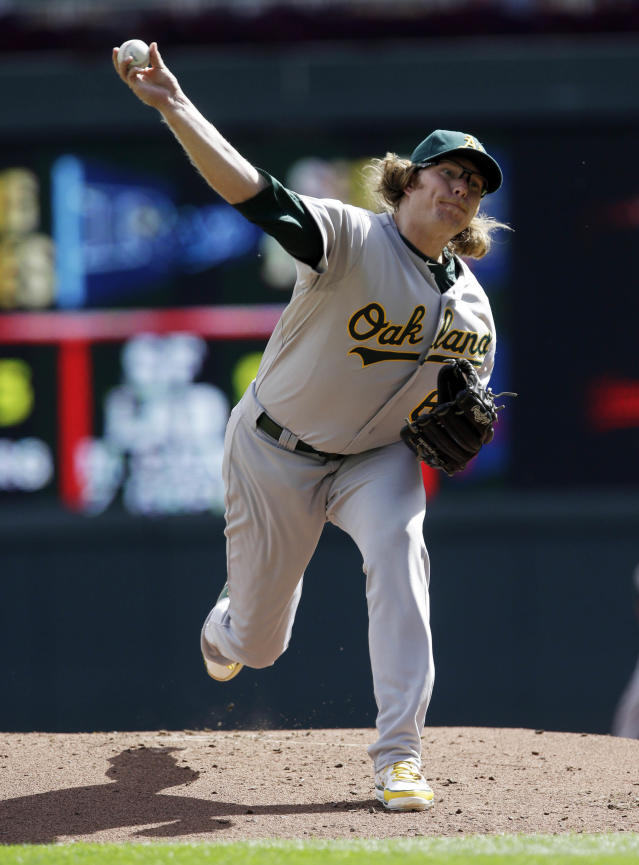 Oakland Athletics pitcher A.J. Griffin throws against the Minnesota Twins in the first inning of a baseball game, Thursday, Sept. 12, 2013 in Minneapolis. (AP Photo/Jim Mone)