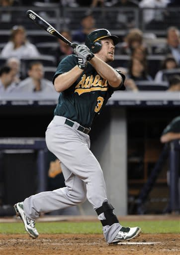 Oakland Athletics' Brandon Moss watches his solo home run off New York Yankees relief pitcher Rafael Soriano that tied the baseball game in the ninth inning on Friday, Sept. 21, 2012, at Yankee Stadium in New York. (AP Photo/Kathy Kmonicek)