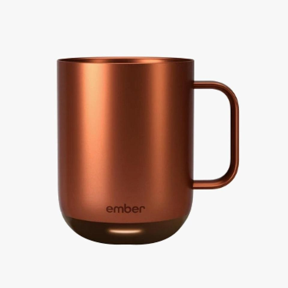 "Ember's smart mugs keep hot beverages hot for hours on end. The brand just launched three festive metallic iterations, perfect for warm sips of coffee and tea over the holiday season. $130, EMBER. <a href=""https://ember.com/products/ember-mug-2-metallic-collection?variant=30845217013845&gclid=Cj0KCQiA2uH-BRCCARIsAEeef3nBaLZQJLiWkte8ar-QFE5g9MXWMRJRAuCw7CLQo0_47PZng-BuSPwaAuobEALw_wcB"" rel=""nofollow noopener"" target=""_blank"" data-ylk=""slk:Get it now!"" class=""link rapid-noclick-resp"">Get it now!</a>"
