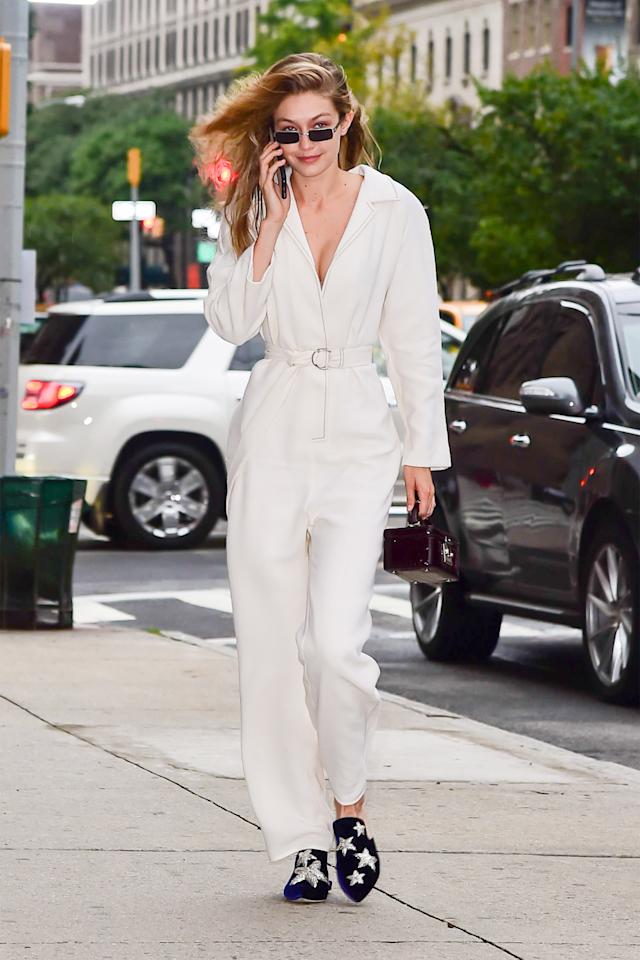 <p>In a Tamuna Ingorokva jumpsuit with Sanayi 313 slippers and a Stalvey mini purse while out in New York City.</p>