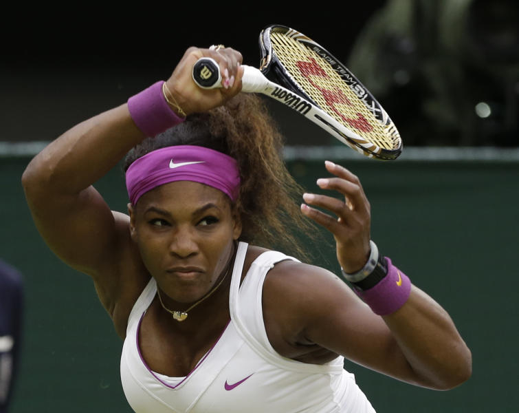 Serena Williams of the United States plays a shot to Petra Kvitova of the Czech Republic during a quarterfinals match at the All England Lawn Tennis Championships at Wimbledon, England, Tuesday, July 3, 2012. (AP Photo/Anja Niedringhaus)