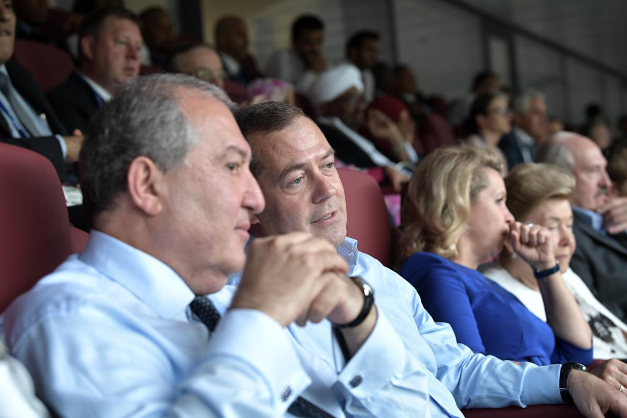Soccer Football - World Cup - Final - France v Croatia -  Luzhniki Stadium, Moscow, Russia - July 15, 2018 Armenian President Armen Sarkissian, Russian Prime Minister Dmitry Medvedev and his wife Svetlana during the game. Sputnik/Alexei Nikolsky/Kremlin via REUTERS ATTENTION EDITORS - THIS IMAGE WAS PROVIDED BY A THIRD PARTY.