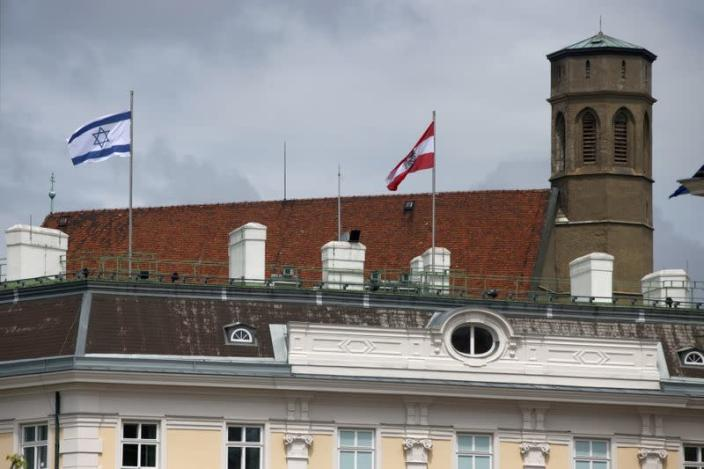 The national flag of Israel is seen atop the federal chancellery in Vienna