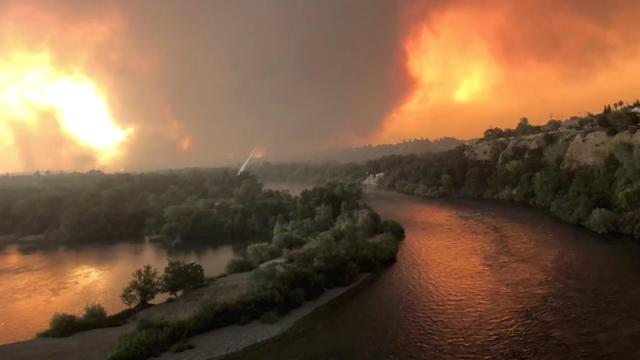 <p>Smoke and flames are seen as a wildfire spreads through Redding, Calif., July 26, 2018, in this still image taken from a video obtained from social media. (Photo: Cody Markhart/via Reuters) </p>