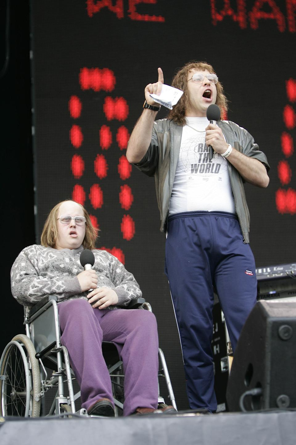 British comedians Matt Lucas, seated in wheelchair, and David Walliams perform at the Live 8 concert in Hyde Park, London, Saturday, July 2, 2005.The concert is part of a series of free concerts being held around the world designed to press leaders of the rich G8 countries to help impoverished African nations. (AP Photo/Lefteris Pitarakis)