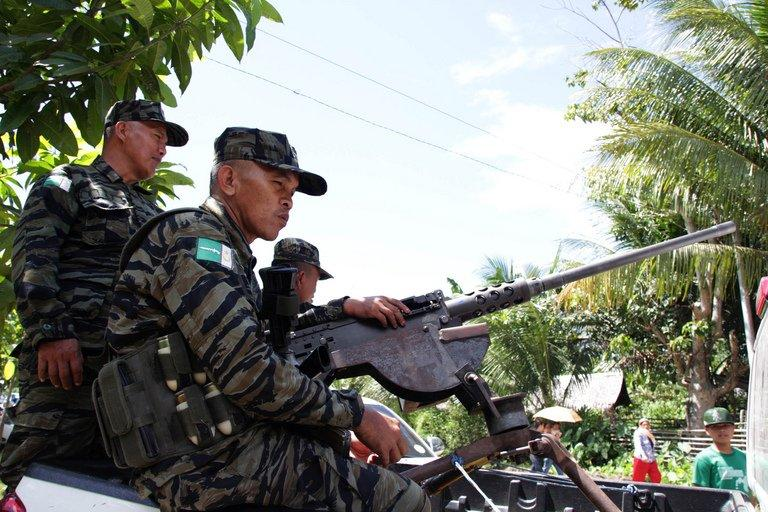 Moro Islamic Liberation Front rebels man a machine gun on the Philippine island of Mindanao on February 11, 2013