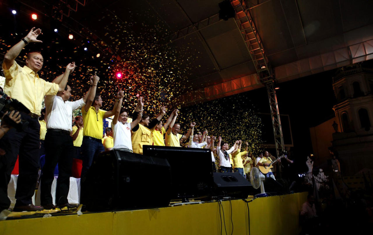 """Liberal Party (LP) chairman President Benigno S. Aquino III raises the hands of the Senatorial candidates during the Team PNoy Senate Campaign Launch at the Plaza Miranda in Quiapo, Manila City on Tuesday (February 12, 2013). The administration candidates for the midterm elections are Aurora Lone District Representative Juan Edgardo Sonny Angara, former National Youth Commission (NYC) chairperson Paolo Benigno Bam Aquino IV, former Akbayan Partylist Representative Ana Theresia Risa Hontiveros-Baraquel, Senators Alan Peter Compañero Cayetano and Francis Joseph """"Chiz"""" Escudero, former Movie and Television Review and Classification Board (MTRCB) chairperson Mary Grace Poe-Llamanzares, Senator Loren Legarda, former Senators Maria Ana Consuelo """"Jamby"""" Madrigal and Ramon Magsaysay, Jr., Senators Aquilino Martin Koko Pimentel III and Antonio Sonny Trillanes IV, and former Las Piñas Representative Cynthia Villar. Team PNoy is the coalition of the Liberal Party (LP), Nacionalista Party (NP), Nationalist People's Coalition (NPC), Laban ng Demokratikong Pilipino (LDP) and the Akbayan Citizens Action Party (Akbayan). The latest survey shows the Filipinos' high preference for Team PNoy senatorial candidates is an indication of their confidence to President Aquino and his team. (Photo by: Benhur Arcayan/MPB/NPPA Images)"""