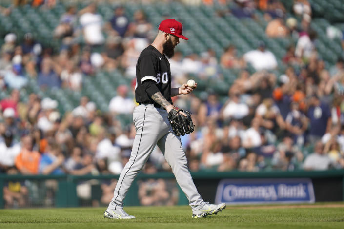 Chicago White Sox pitcher Dallas Keuchel looks at the ball after allowing a Detroit Tigers run in the fifth inning of a baseball game in Detroit, Saturday, July 3, 2021. (AP Photo/Paul Sancya)