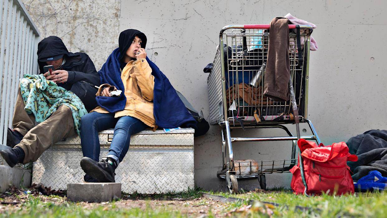 John and a woman, both homeless, sit in a courtyard at Library Square where they try and sleep most nights on May 1, 2019, in downtown Salt Lake City. (Photo: Kim Raff for HuffPost)