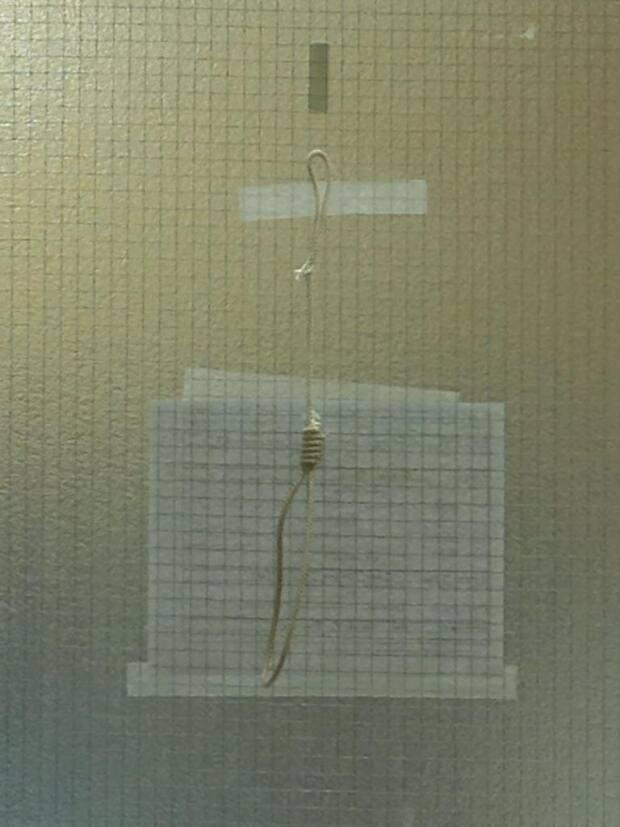 A lawyer for the College of Physicians and Surgeons of Alberta's complaints director said Wednesday that Dr. Wynand Wessels should receive a one-year suspension for tying this noose and taping it to an operating room door in 2016. Wessels' lawyer argued for a much lighter penalty. (Submitted by Dr. Carrie Kollias - image credit)