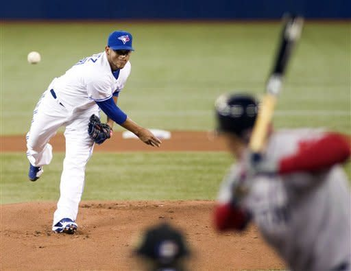 Toronto Blue Jays starter Henderson Alvarez throws out the first pitch of the Jays' home-opener baseball game against the Boston Red Sox in Toronto on Monday, April 9, 2012. (AP Photo/The Canadian Press, Frank Gunn)